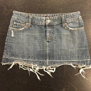 American Eagle denim jean skirt. Frayed hem